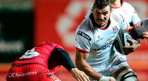 Ulster's Sean Reidy is tackled by Uzair Cassiem of Scarlets. Photo: Gareth Everett/Sportsfile