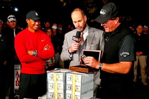 Phil Mickelson reacts with the winner's belt after beating winning The Match: Tiger vs Phil golf match at Shadow Creek Golf Course. Mandatory Credit: Rob Schumacher-USA TODAY Sports