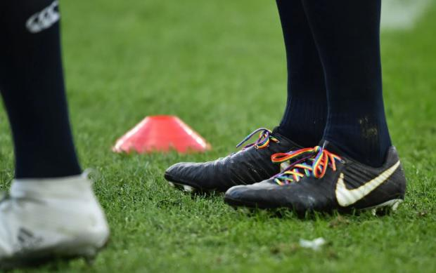 Rainbow laces are worn to raise awareness of LGBT issues in sport CREDIT: AFP