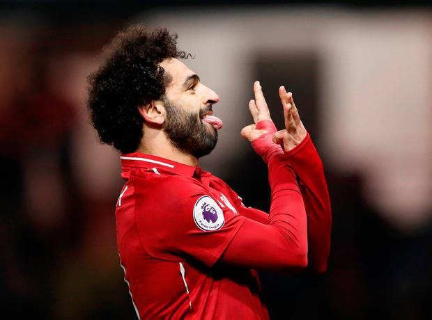 Liverpool's Mohamed Salah celebrates scoring their first goal. Action Images via Reuters/Carl Recine