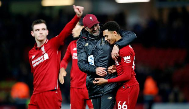 Liverpool manager Jurgen Klopp and Trent Alexander-Arnold celebrate after the match