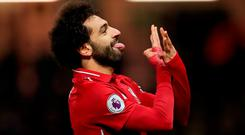Mohamed Salah of Liverpool celebrates after scoring his team's first goal during the Premier League match between Watford FC and Liverpool FC at Vicarage Road on November 24, 2018 in Watford, United Kingdom. (Photo by Richard Heathcote/Getty Images)