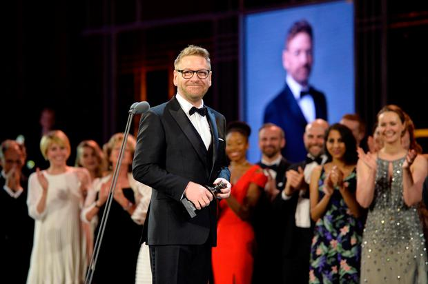Kenneth Branagh with his Special Award on stage during The Olivier Awards 2017 at Royal Albert Hall