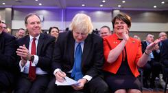 CONSEQUENCES: Nigel Dodds, Boris Johnson and Arlene Foster during the DUP annual conference in Belfast. Picture: PA