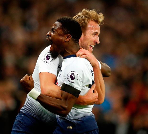 Serge Aurier celebrates with Harry Kane after scoring his side's second goal against Chelsea yesterday. Photo: Frank Augstein/AP