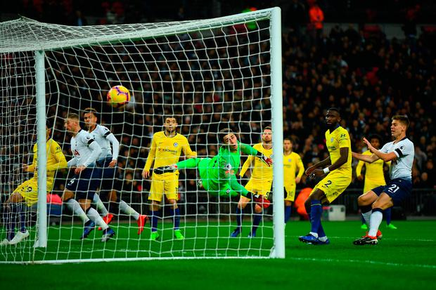 Kepa Arrizabalaga of Chelsea can't stop a header from Dele Alli of Tottenham Hotspur hitting the back of the net. Photo: Getty