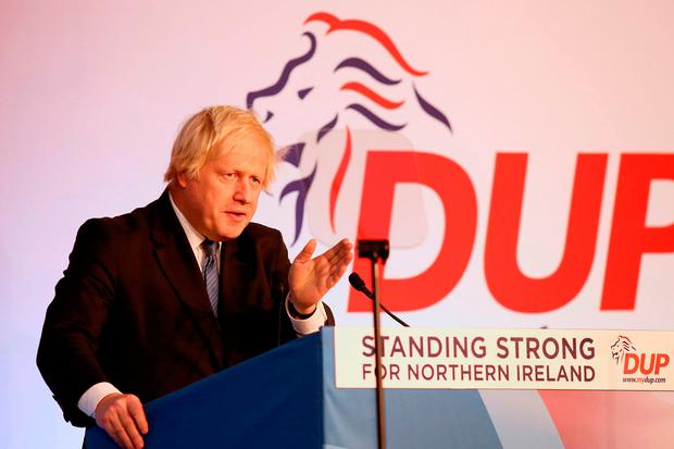 ANY PORT IN A STORM: Boris Johnson at the DUP annual conference in Belfast yesterday. Photo: Paul Faith