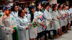 This handout picture released by Cuban News Agency (ACN) shows the first group of doctors who arrived from Brazil after the Cuban government decided to pull them out of a medical aid program. Photo: Getty