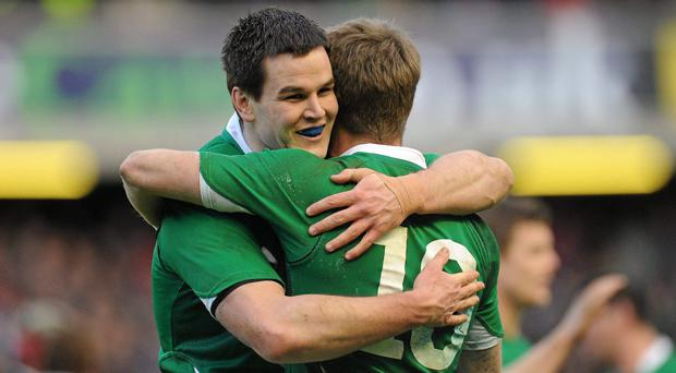 Johnny Sexton and Ronan O'Gara embrace after a Six Nations victory in 2011