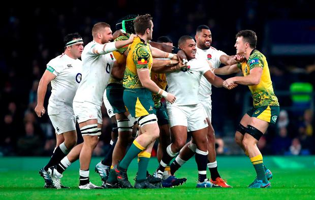Kyle Sinckler of England clashes with Jack Dempsey (R) of Australia during the Quilter International match between England and Australia at Twickenham