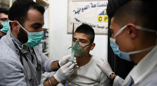 Syrian warplanes strike rebel areas after alleged gas attack