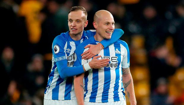 Huddersfield Town's Florent Hadergjonaj (left) and Aaron Mooy celebrate after during the Premier League match at Molineux, Wolverhampton.