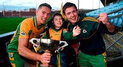 Corofin supporter Tomás McLoughlin, aged 8, with Mike Farragher, left, and Dylan Wall after yesterday's Connacht final victory. Photo by David Fitzgerald/Sportsfile