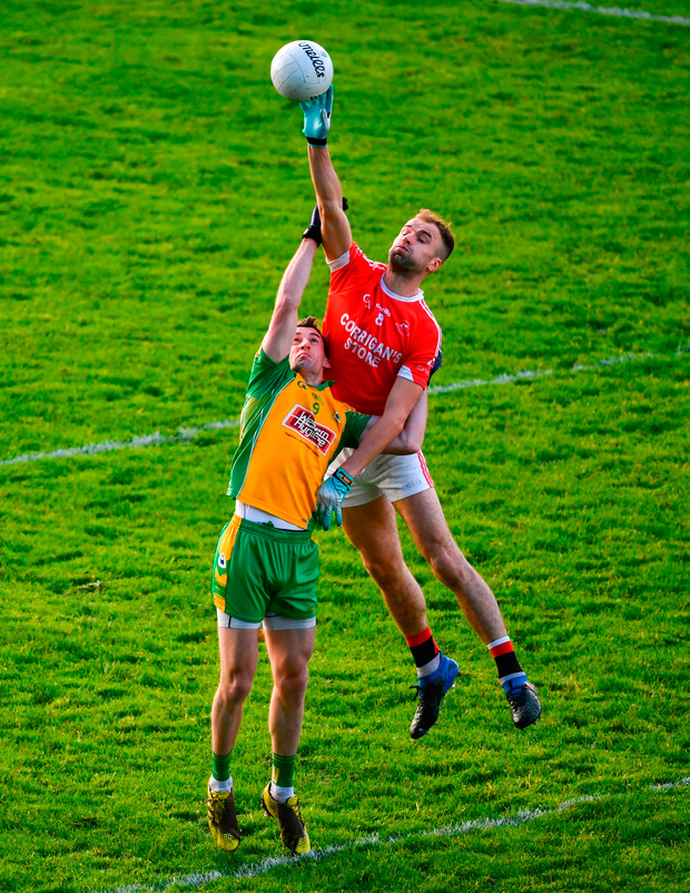 Jason Gibbons of Ballintubber in an aerial duel with Corofin's Ronan Steede. Photo by David Fitzgerald/Sportsfile