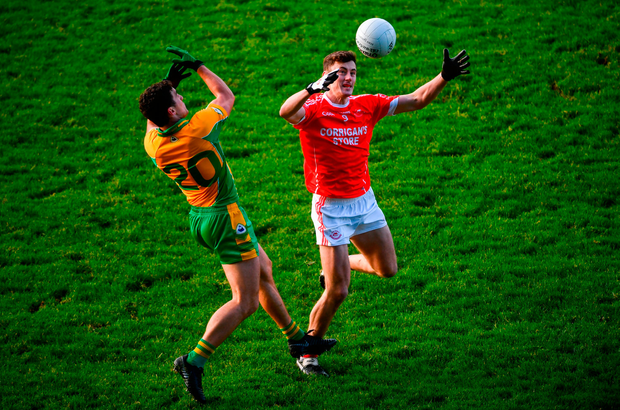 Diarmuid O'Connor of Ballintubber in action against Daithi Burke of Corofin. Photo by David Fitzgerald/Sportsfile