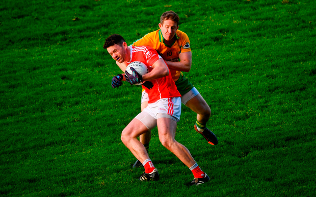 Ruaidhri O'Connor of Ballintubber is tackled by Gary Sice of Corofin. Photo by David Fitzgerald/Sportsfile