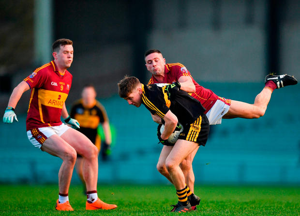 Michael Potts of Dr Crokes is tackled by Graham Kelly of St Josephs Miltown Malbay. Photo by Eóin Noonan/Sportsfile