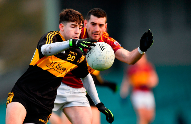 Jordan Kiely of Dr Crokes in action against Enda OGorman of St Josephs Miltown Malbay. Photo by Eóin Noonan/Sportsfile