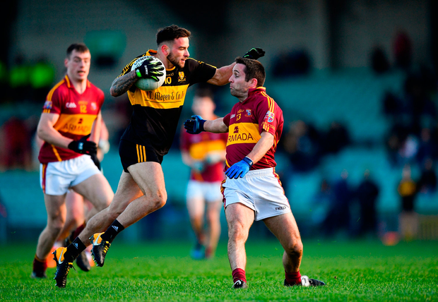 Micheál Burns of Dr Crokes is tackled by Brian Curtin of St Josephs Miltown Malbay. Photo by Eóin Noonan/Sportsfile