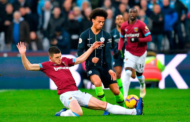 Declan Rice gets his foot in to stop the progress of Leroy Sane during Manchester City's victory against West Ham. Photo: PA