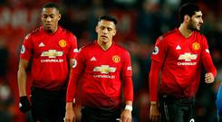 Manchester United's Anthony Martial, Alexis Sanchez and Marouane Fellaini cut frustrated figures after the stalemate against Crystal Palace. Photo: REUTERS