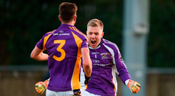 Penalty hero: Kilmacud Crokes goalkeeper David Nestor is congratulated by team-mate Andrew McGowan (No 3) after he saved an injury-time Portlaoise penalty in the AIB Leinster club semi-final. Photo by Daire Brennan/Sportsfile