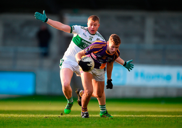 Callum Pearson of Kilmacud Crokes in action against Scott Lawless of Portlaoise. Photo by Daire Brennan/Sportsfile