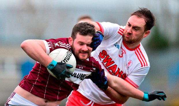 Mullinalaghta's James McGivney is tackled by Mark Fitzgerald of Éire Óg. Photo by Matt Browne/Sportsfile