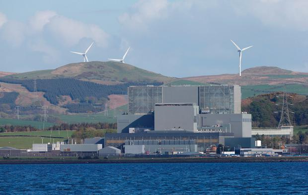 Power conflict: Wind turbines are seen behind Hunterston B Nuclear Power Station in West Kilbride, Scotland. Photo: Reuters