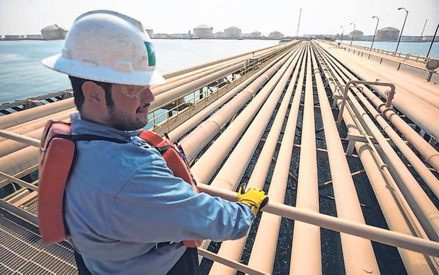 Oil supply: An employee looks out over transport pipelines on the Arabian Sea in Saudi Aramco's Ras Tanura oil refinery and oil terminal as the debate over Opec power goes on in the US. Photo: Bloomberg