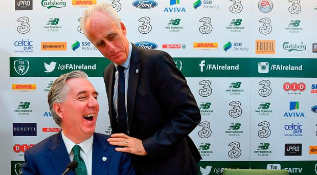 Mick McCarthy and John Delaney share a joke at the press conference in the Aviva Stadium. Photo: Ramsey Cardy/Sportsfile