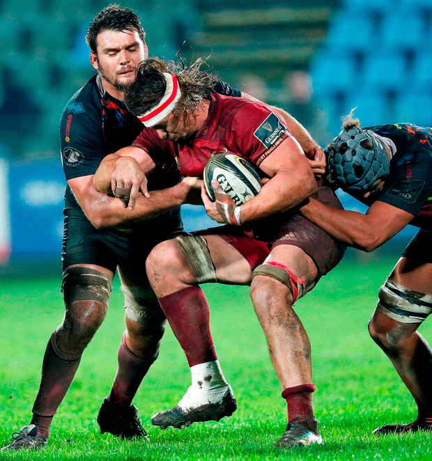 Arno Botha of Munster Rugby is tackled by David Sisi, left, and Leonard Krumov of Zebre. Photo by Roberto Bregani/Sportsfile