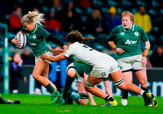 Alisa Hughes of Ireland is tackled by Abbie Scott of England. Photo by Matt Impey/Sportsfile