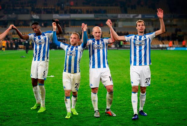 Left to right, Huddersfield Town's Terence Kongolo, Alex Pritchard, Aaron Mooy and Jon Gorenc Stankovic celebrate with their travelling fans at the end of the game. Photo: Nick Potts/PA Wire