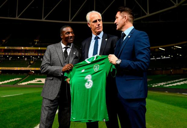 Newly appointed Ireland manager Mick McCarthy with assistant coaches Terry Connor, left, and Robbie Keane