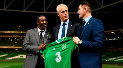 Newly appointed Ireland manager Mick McCarthy with assistant coaches Terry Connor, left, and Robbie Keane following yesterday's press conference at the Aviva Stadium. Photo: Stephen McCarthy/Sportsfile