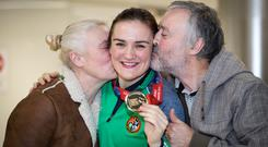 Champion: Parents Yvonne and Christy welcome home Kellie Harrington as she arrives at Dublin Airport. Photo: Arthur Carron