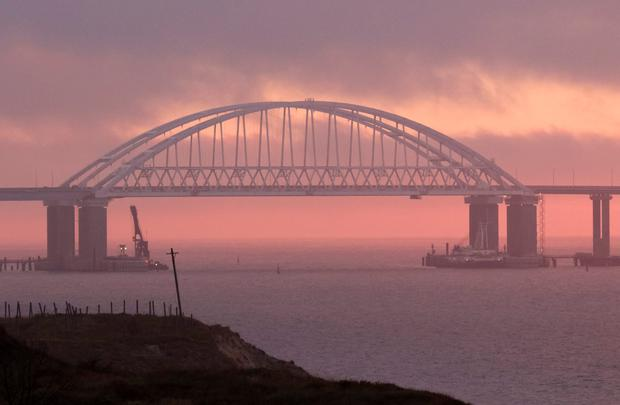 A general view shows a road-and-rail bridge which is constructed to connect the Russian mainland with the Crimean peninsula at sunrise in the Kerch Strait Crimea