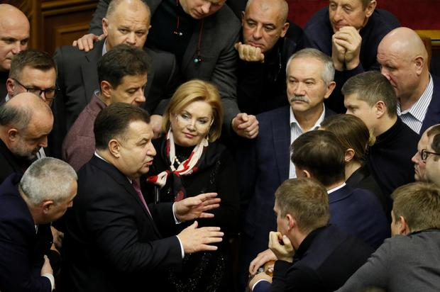 Ukrainian Defence Minister Stepan Poltorak speaks with lawmakers during a parliament session to review a proposal by Ukrainian President Petro Poroshenko to introduce martial law for 60 days after Russia seized Ukrainian naval ships off the coast of Russia-annexed Crimea, in Kiev, Ukraine November 26, 2018. REUTERS/Valentyn Ogirenko