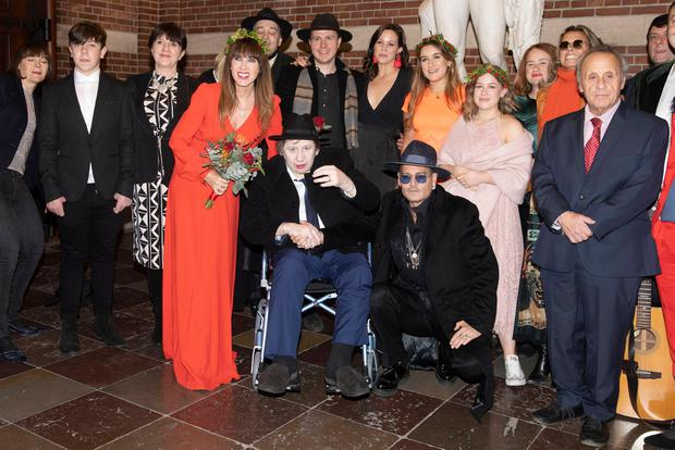Celebration: Shane MacGowan and Victoria Mary Clarke, with Johnny Depp and wedding guests. Photo: Aller/MEGA