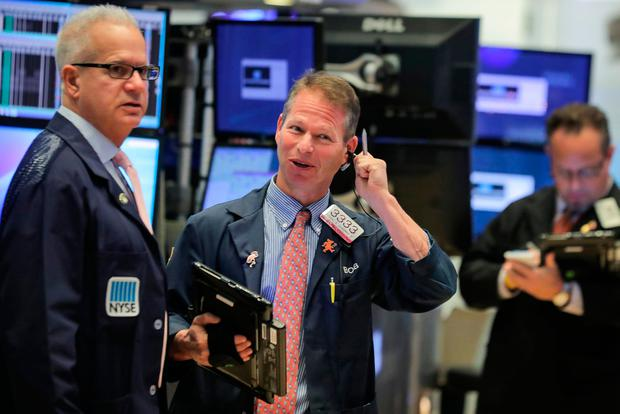 Traders work on the floor at the New York Stock Exchange (NYSE)