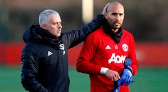 Manchester United manager Jose Mourinho and reserve goalkeeper Lee Grant during training in Carrington yesterday. Photo: Reuters/Carl Recine
