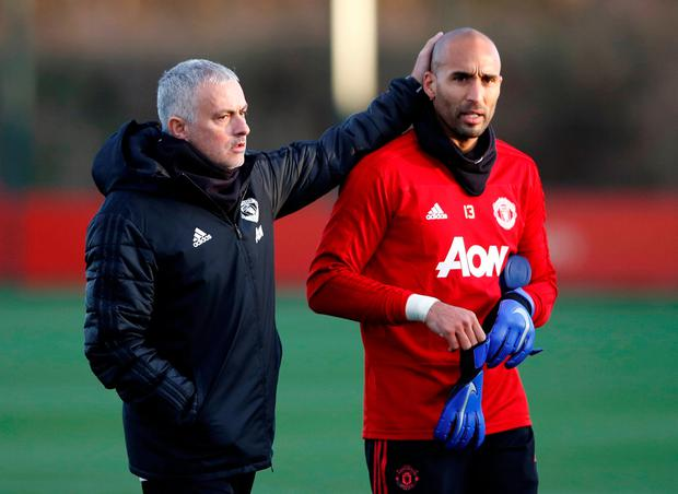 Manchester United manager Jose Mourinho and reserve goalkeeper Lee Grant during training in Carrington yesterday