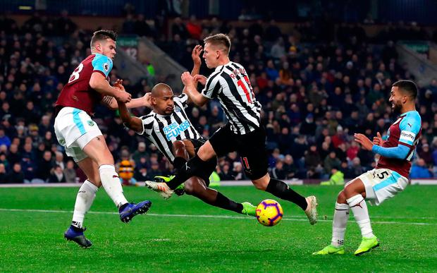 Newcastle United's Salomon Rondon (centre left) and Matt Ritchie go for the same ball during last night's victory against Burnley. Photo credit: Martin Rickett/PA Wire