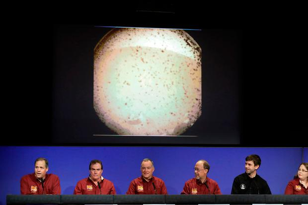 From left, NASA officials Jim Bridenstine, Michael Watkins, Tom Hoffman, Bruce Banerdt, Andrew Klesh and Elizabeth Barrett make statements under a photograph sent from Mars by the InSight lander at NASA's Jet Propulsion Laboratory Monday, Nov. 26, 2018, in Pasadena, Calif. (AP Photo/Marcio Jose Sanchez)