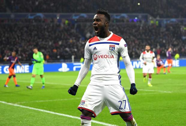 Lyon's Ivorian forward Maxwell Cornet celebrates after scoring a goal during the UEFA Champions League Group F football match between Olympique Lyonnais and Manchester City at the Parc Olympique Lyonnais stadium in Decines-Charpieu, central-eastern France, on November 27, 2018. (Photo by JEFF PACHOUD / AFP) (Photo credit should read JEFF PACHOUD/AFP/Getty Images)