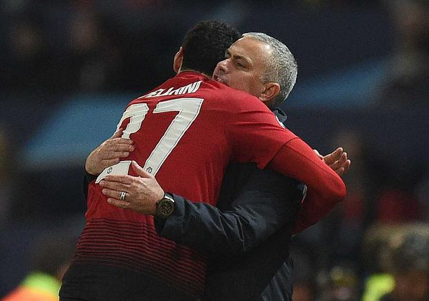 Marouane Fellaini of Manchester United and Jose Mourinho, Manager of Manchester United embrace after the UEFA Champions League Group H match between Manchester United and BSC Young Boys at Old Trafford on November 27, 2018 in Manchester, United Kingdom. (Photo by Clive Brunskill/Getty Images)