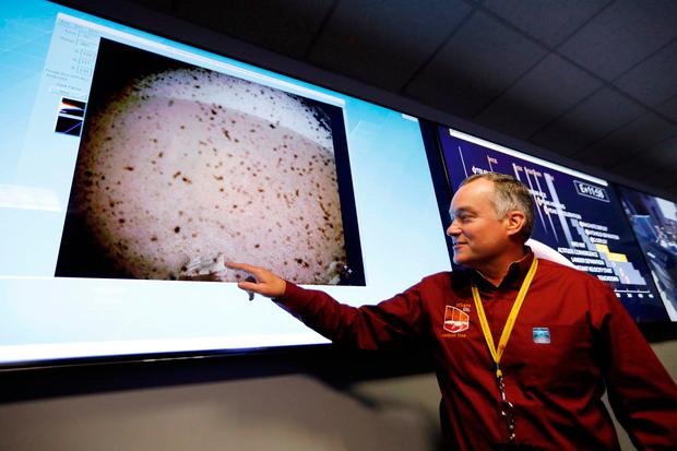 InSight project manager Tom Hoffman points at an image sent from the InSight lander after the space craft landed on Mars in the mission support area of the space flight operation facility at NASA's Jet Propulsion Laboratory in Pasadena, California. AP Photo/(Al Seib /Los Angeles Times via AP, Pool