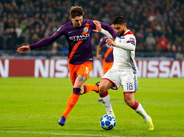 Manchester City's John Stones in action with Lyon's Nabil Fekir. Photo: Emmanuel Foudrot/Reuters