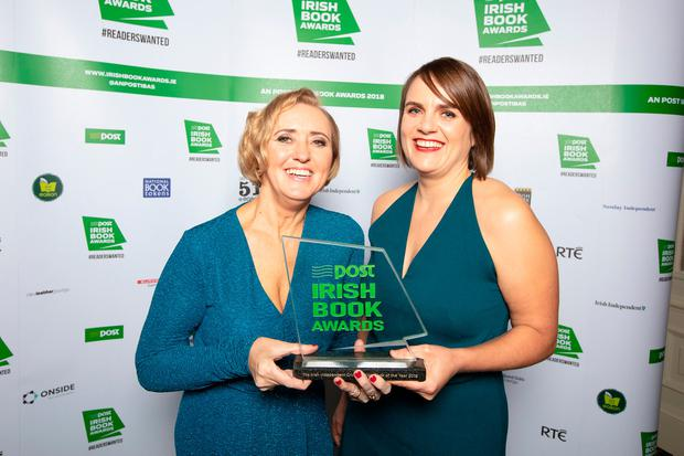 Liz Nugent receives the Irish Independent Crime Fiction Book of the Year award from Rachel Dugan. Photo: Pat Bolger